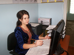 A Melhem staff member using her new ICT skills acquired at IATP for routine paperwork